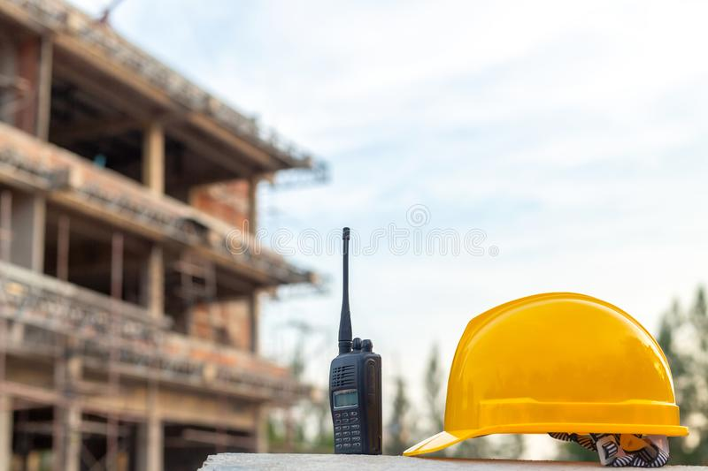 Radio and helmet in construction site and construction site work royalty free stock image