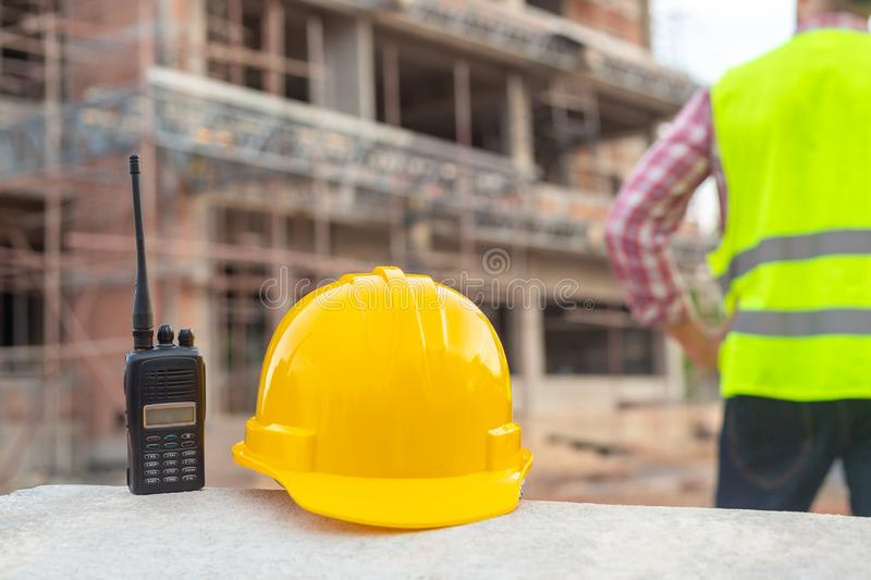 Radio and helmet in construction site and construction site work stock images