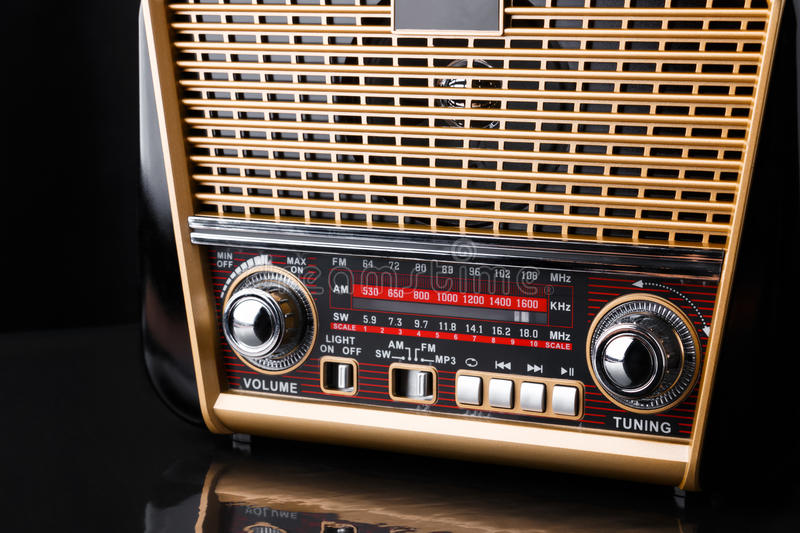 Radio receiver in retro style with audio player on black background stock images