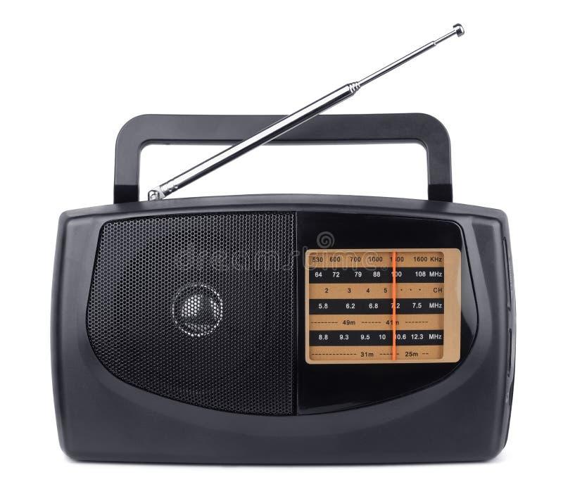 Radio. Small transistor radio receiver isolated on white stock photography