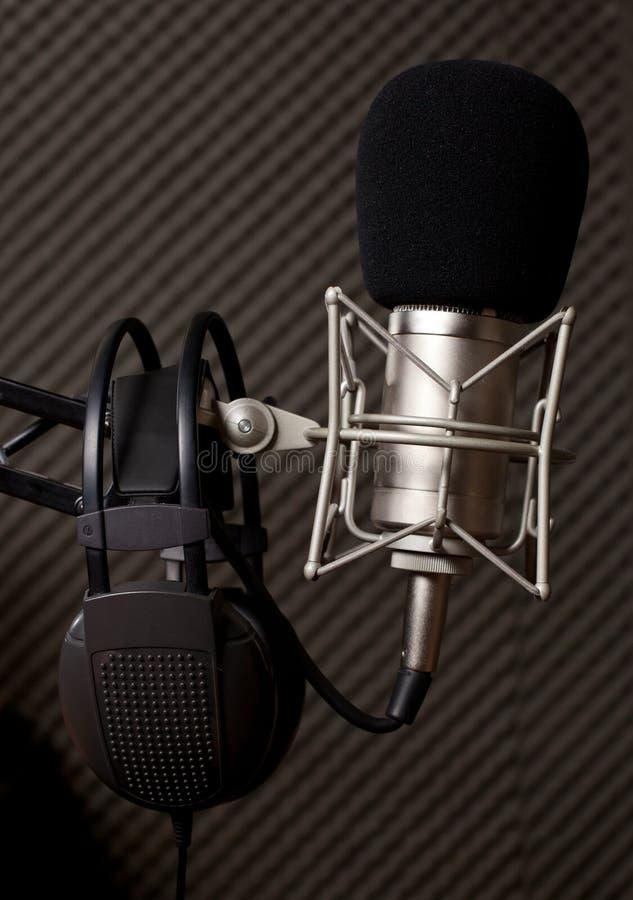 Radio studio. Microphone and big headphone royalty free stock photography