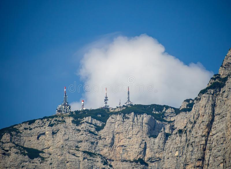Radio telecommunications masts, towers on mountain top in th Dolomites, South Tyrol, Italy. royalty free stock photography