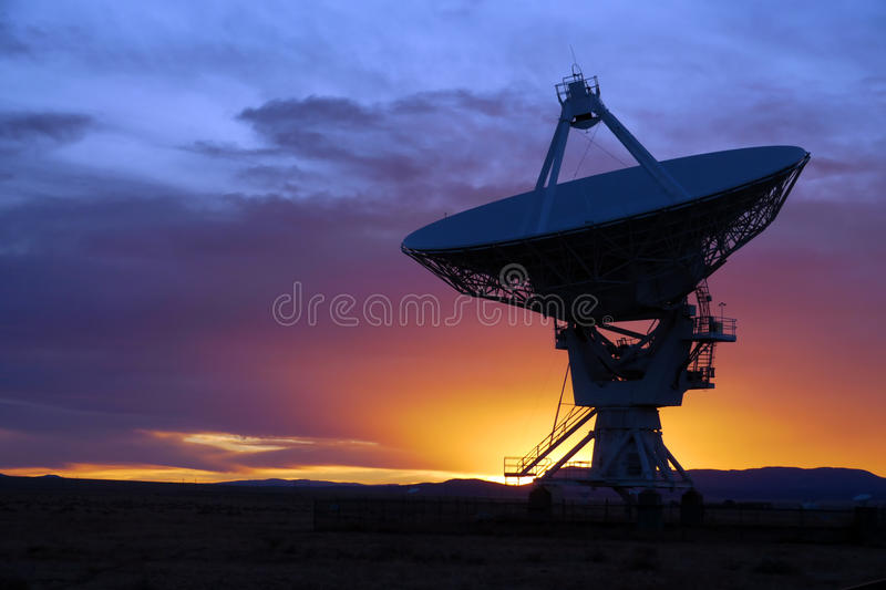 Radio Telescope. Silhouette of a radio telescope at the Very Large Array (VLA) in New Mexico, USA, at sunset royalty free stock photography
