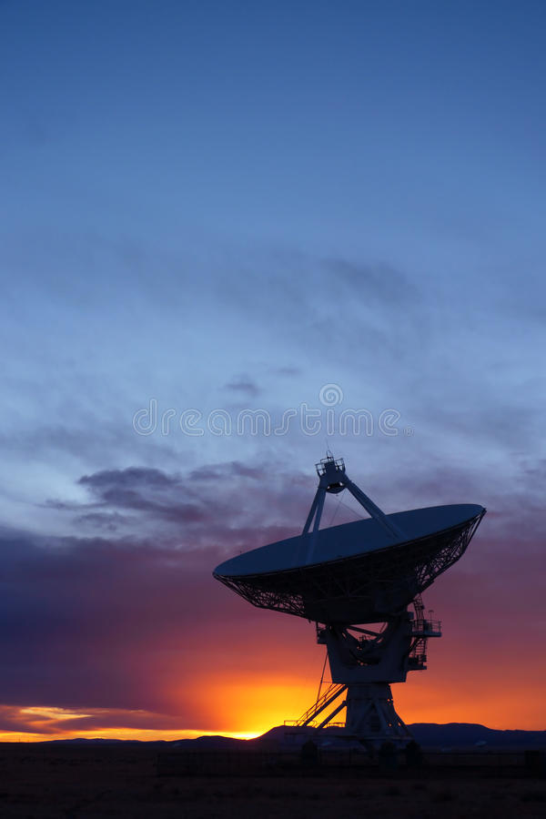 Radio Telescope. Silhouette of a radio telescope at the Very Large Array (VLA) in New Mexico, USA, at sunset stock photos