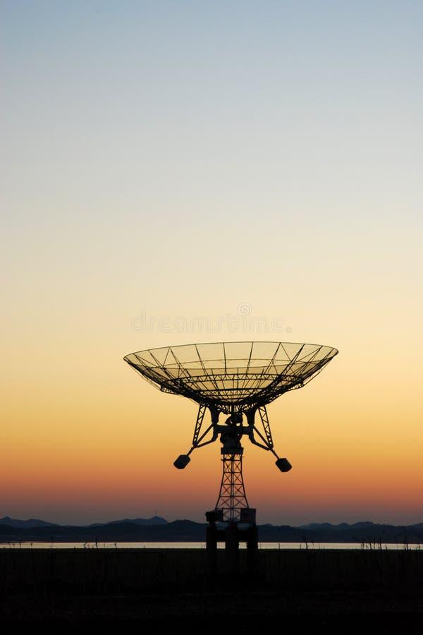 Radio telescope. A radio telescope in sunset stock images