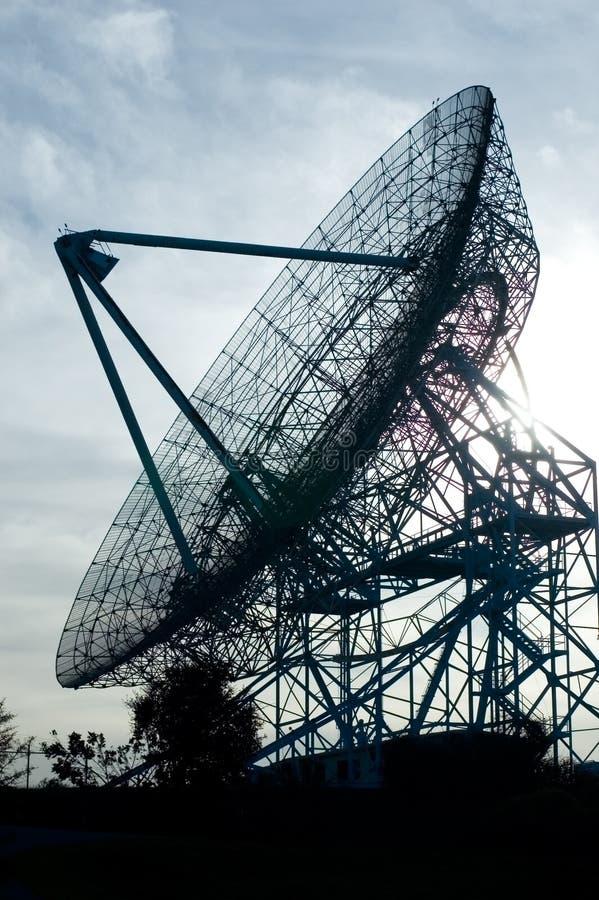 Radio telescope dish. Against the sun stock images