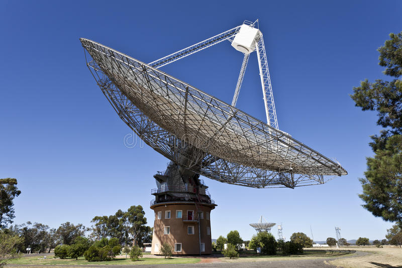 Radio Telescope Dish in Parkes, Australia. The historical radio telescope dish which actively took part in the 1969 first landing of man in the moon located in stock images