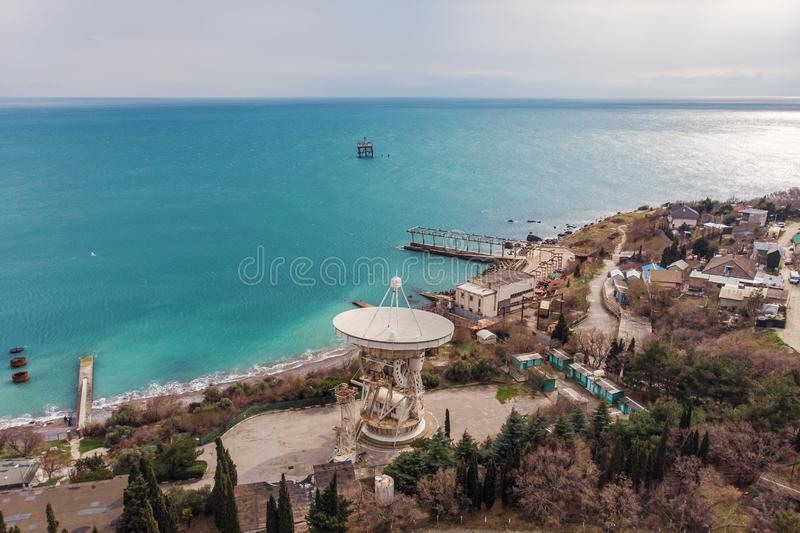 Radio telescope RT-22 in Simeiz Observatory, Crimea. Big white satellite dish antenna on sea coast for astronomy research royalty free stock image