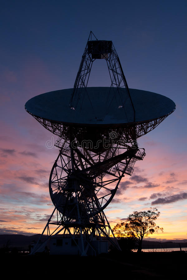 Radio Telescope Sunrise. Mt Pleasant 26m radio telescope, Cambridge, Tasmania. Silhouette at sunrise royalty free stock photography