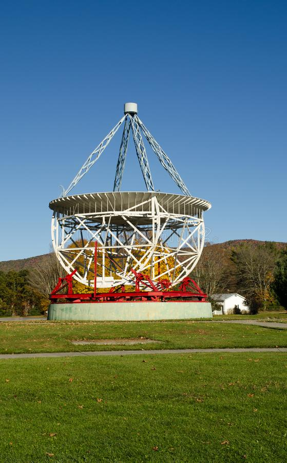 Radio Telescope In West Virginia. A radio telescope in West Virginia. It`s red and white and made of metal. This is from Green Bank West Virginia observatory stock images