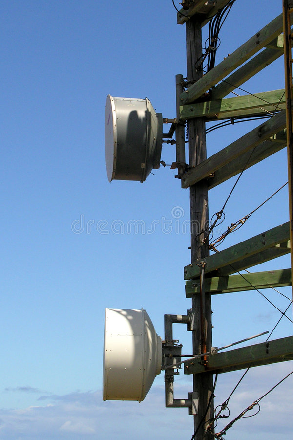 Radio tower. Telecommunication tower over a blue afternoon sky - advancing technology stock images
