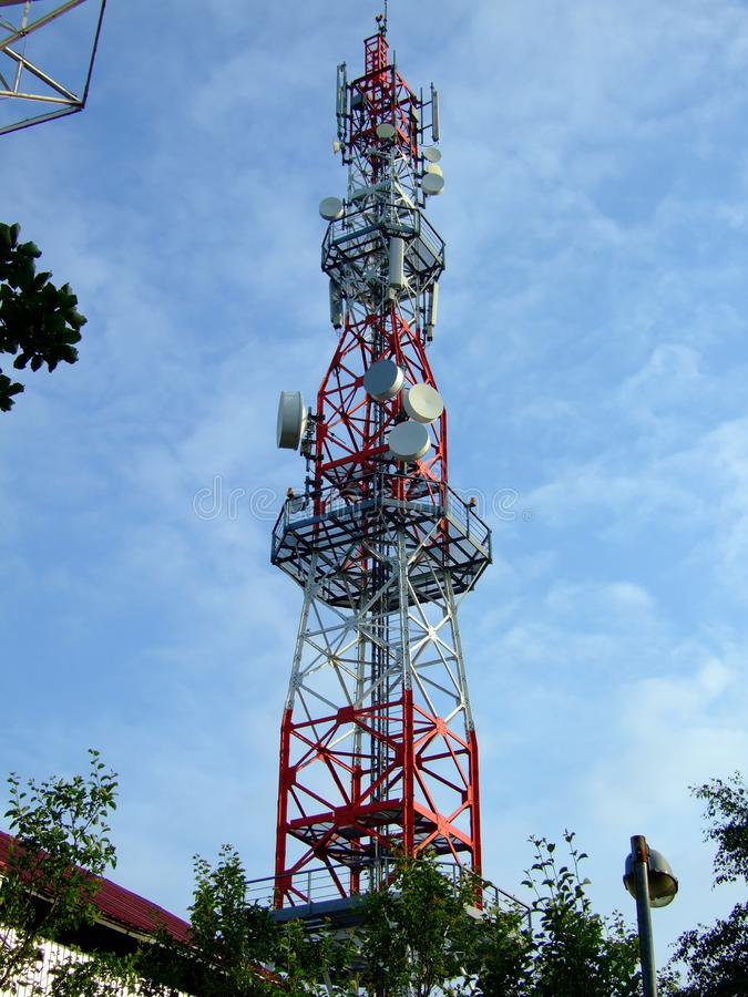 Radio tower with devices for internet and mobile communication. And other elements royalty free stock image