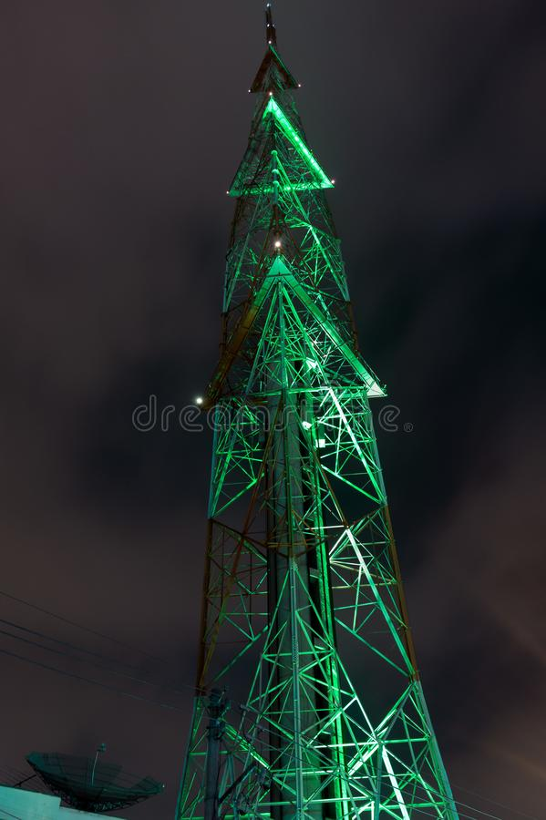 Radio tower, night, green lights royalty free stock image