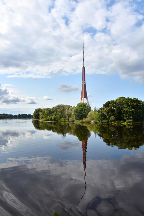 Radio tower in Riga and reflection in river daugava stock photography