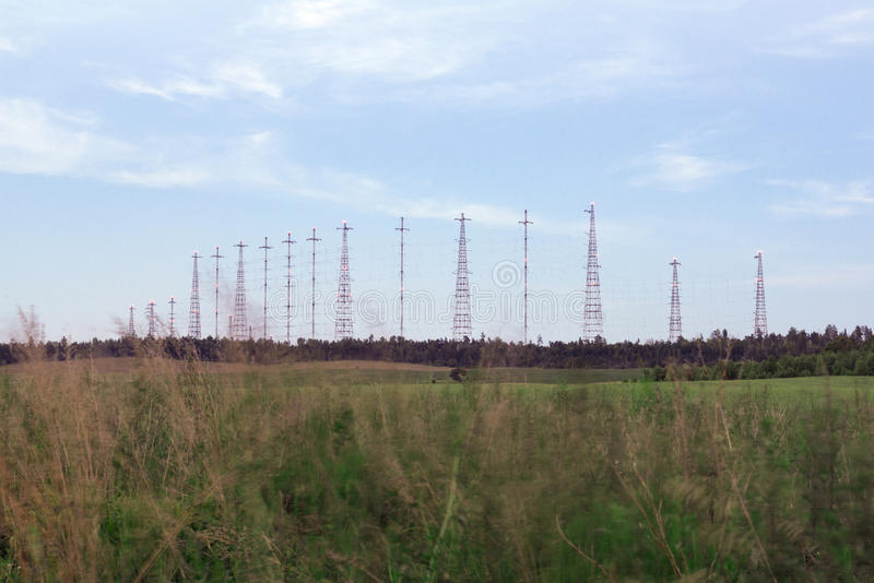 Radio towers in the field stock photos
