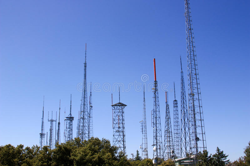 Radio towers in the sky stock photography