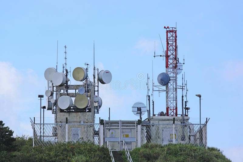Radio transmitter antenna station. On hilltop stock images