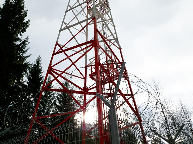 Radio tv radio communication. Communication tower in the forest close up. The Radio tv radio communication. Communication tower in the forest close up royalty free stock images