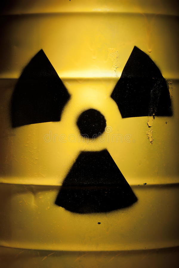 Radioactive Barrel with Nuclear Sign. Yellow Radioactive Barrel Close Up with Nuclear Sign royalty free stock photo