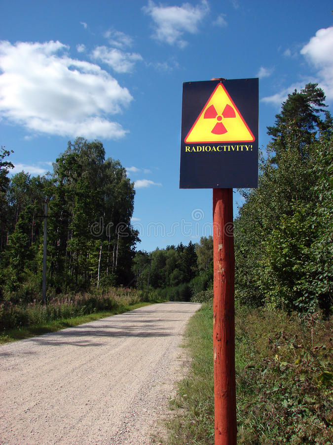 Radioactive contamination. Sign on a forest road stock images