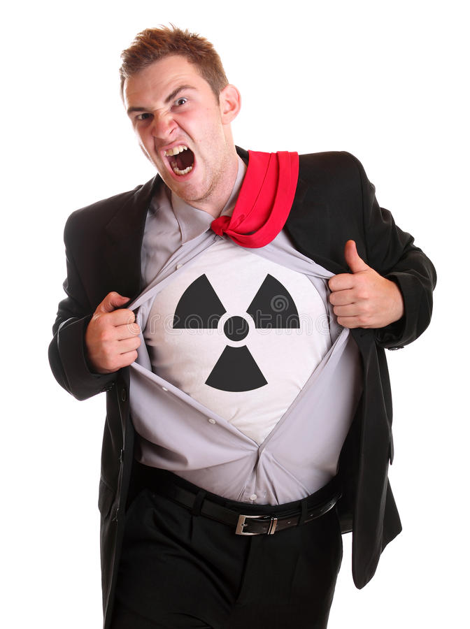 Radioactive guy. Young angry businessman tearing his shirt - radioactive symbol on it royalty free stock photos