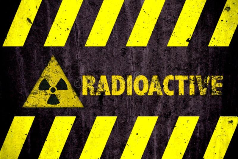 Radioactive ionizing radiation or nuclear energy danger symbol word yellow hazard black stripes painted on concrete royalty free stock image