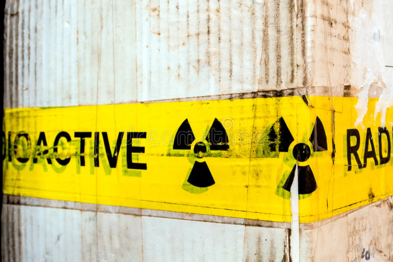 Radioactive material warning sign at the package. Radioactive material warning sign at the transportation paper package stock photography