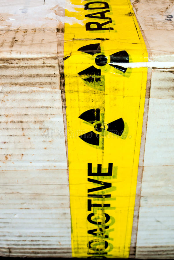 Radioactive material warning sign at the package. Radioactive material warning sign at the transportation paper package royalty free stock images