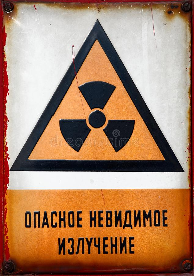 Radioactive Sign. Radioactive area warning sign with russian label stock photos
