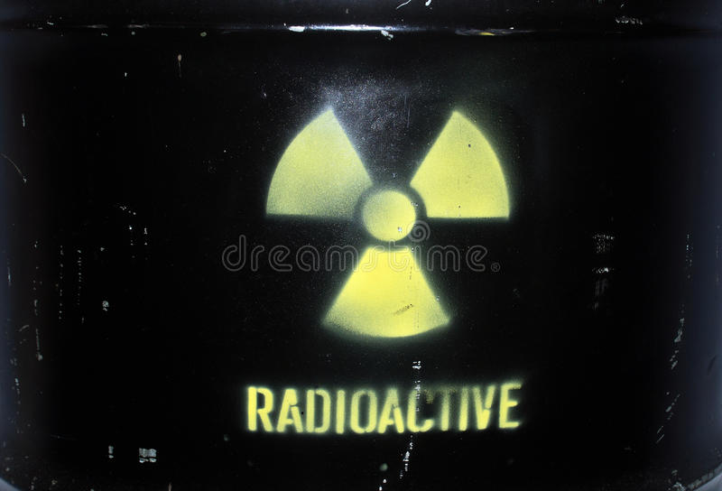 Radioactive sign on barell. Radioactive sign sprayed on metal barell royalty free stock photo