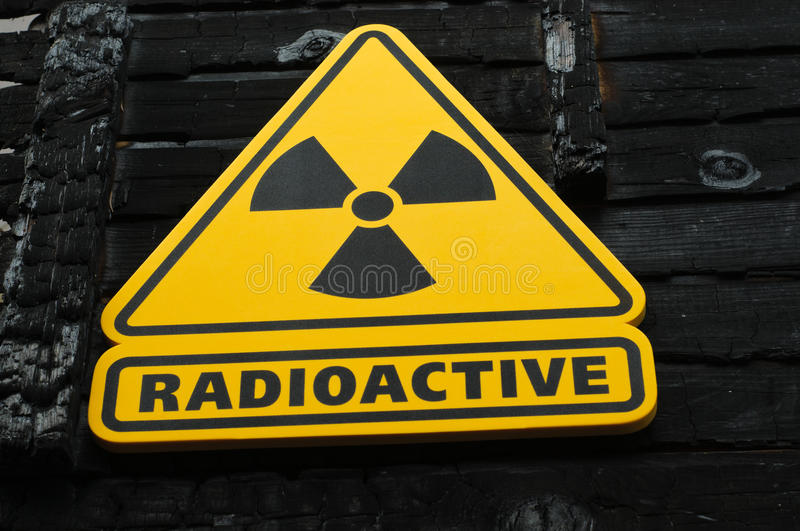 Radioactive Sign. On Burned Wooden Background royalty free stock image