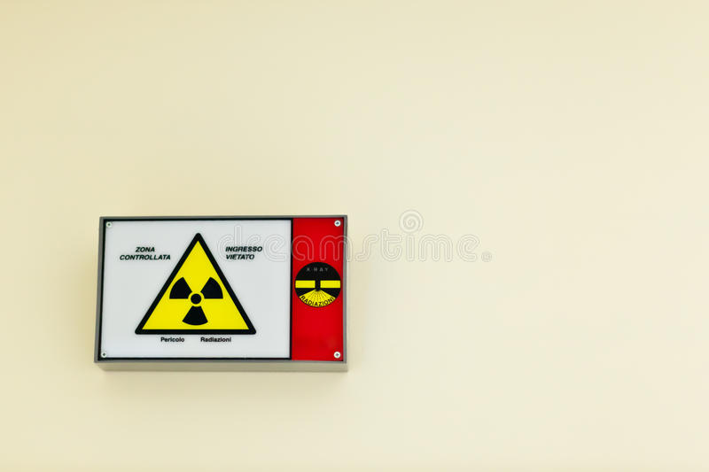 Radioactive sign. On a wall stock photography