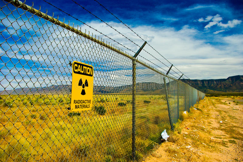 Radioactive Warning. Radioactivity Warning sign saying Radioactive Materials on a fence surrounding the Trinity Site in New Mexico where the very first nuclear royalty free stock photo