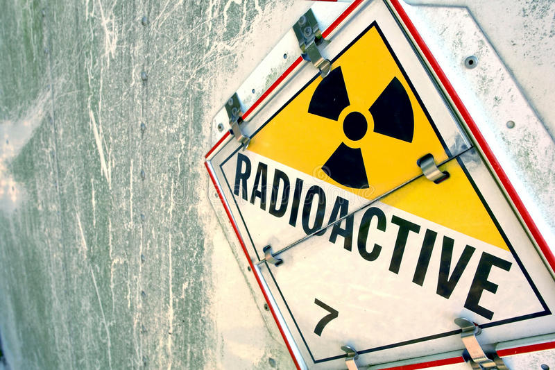 Radioactive Warning Placard Sign. Radioactive danger warning placard sign on grunge metal surface stock photo