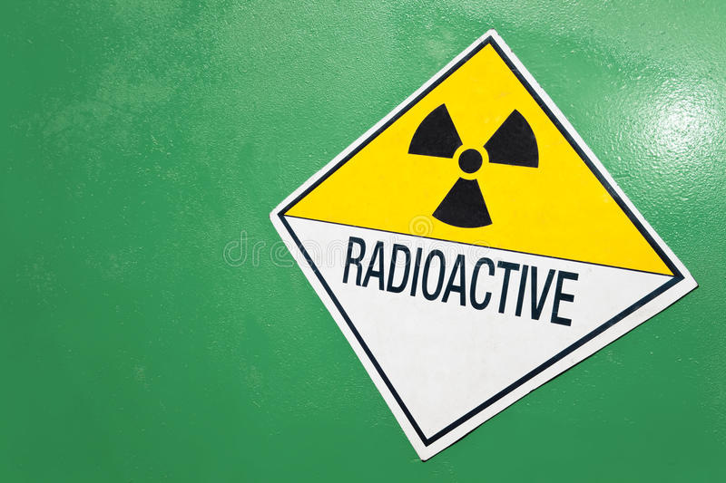 Radioactive Warning Sign on a Green Container. A radioactive warning sign on a green container of radioactive material royalty free stock photo
