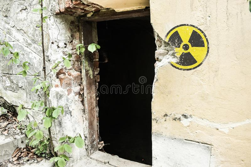 Radioactive warning sign on the grunge dirty wall in abandoned building from the exclusion zone. Chernobyl Pripyat atmosphere.  stock image