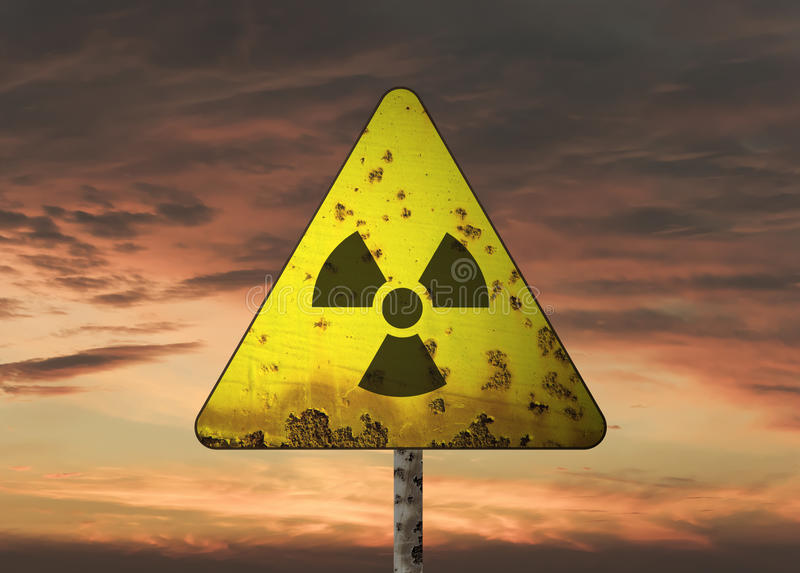 Radioactivity Sign. And the dramatic sky stock images