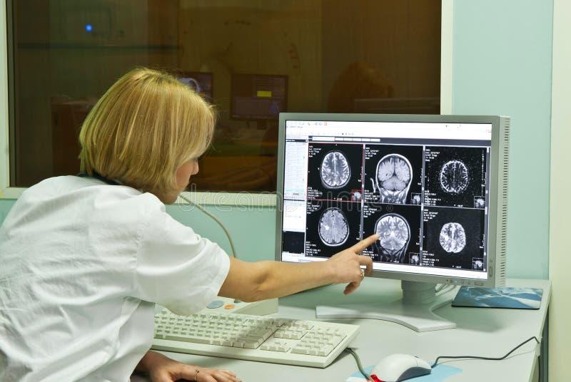 Download Radiologist Analyzing X-ray Image Stock Photo - Image of female, radiologist: 18225118