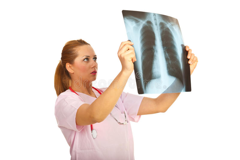 Radiologist woman. Looking on a X-ray isolated on white background royalty free stock image