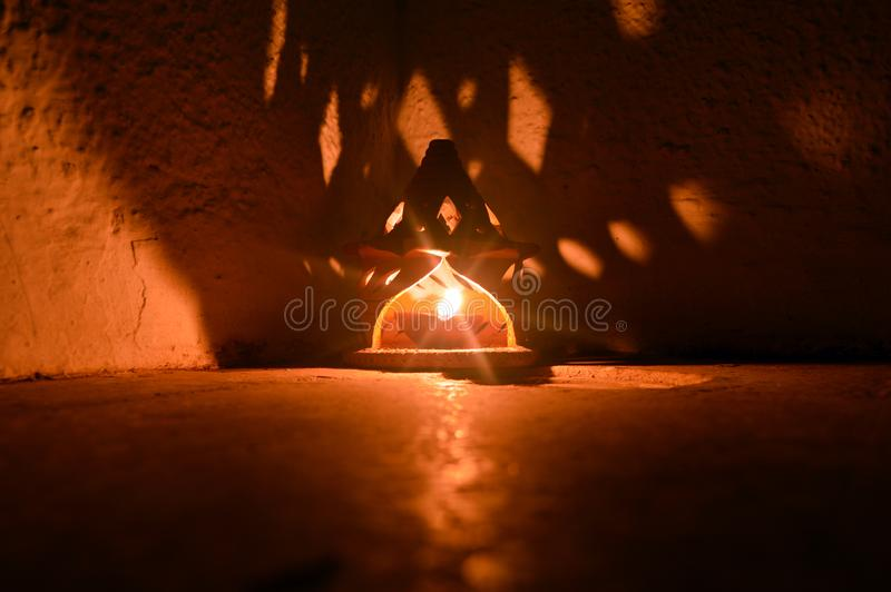 Raditional terracota indian clay diyas and shadows royalty free stock image