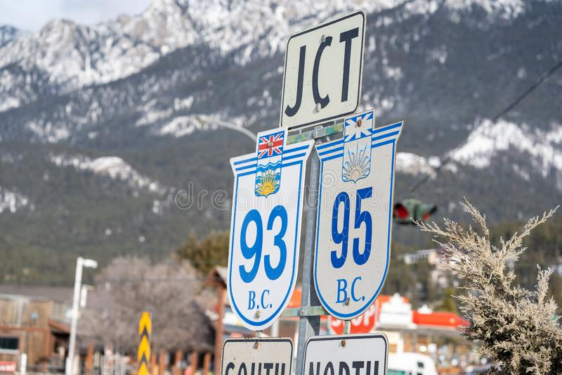 Radium Hot Springs, British Columbia, Canada - Janurary 20, 2019: Road signs indicate the junction of Highway 93 and 95 for stock photos