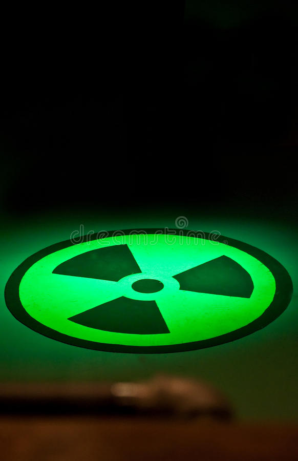 Radium Symbol on Floor in Green Light stock illustration