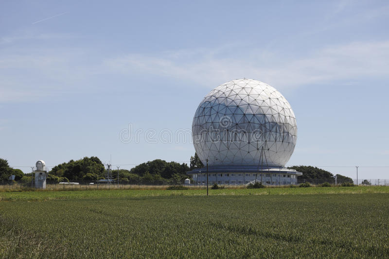 Radome with field in foreground. royalty free stock image