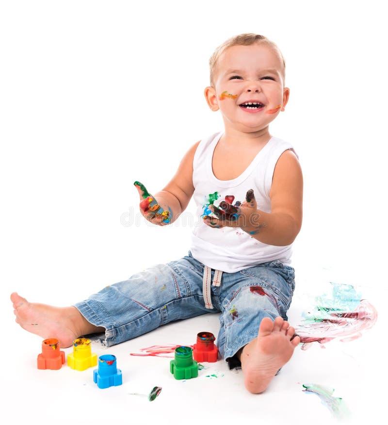 Radosna chłopiec z farbami obraz stock
