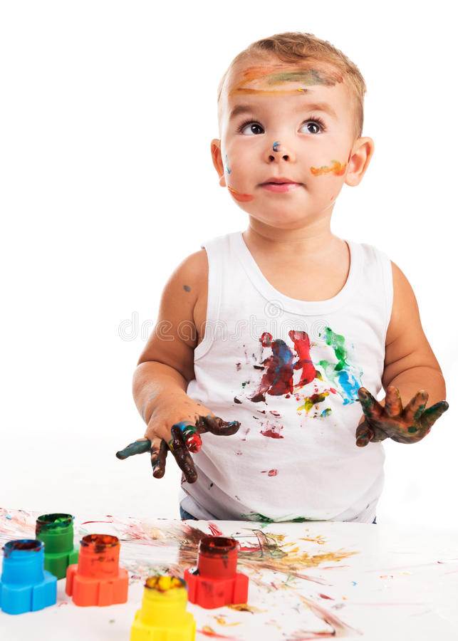 Radosna chłopiec z farbami obraz royalty free