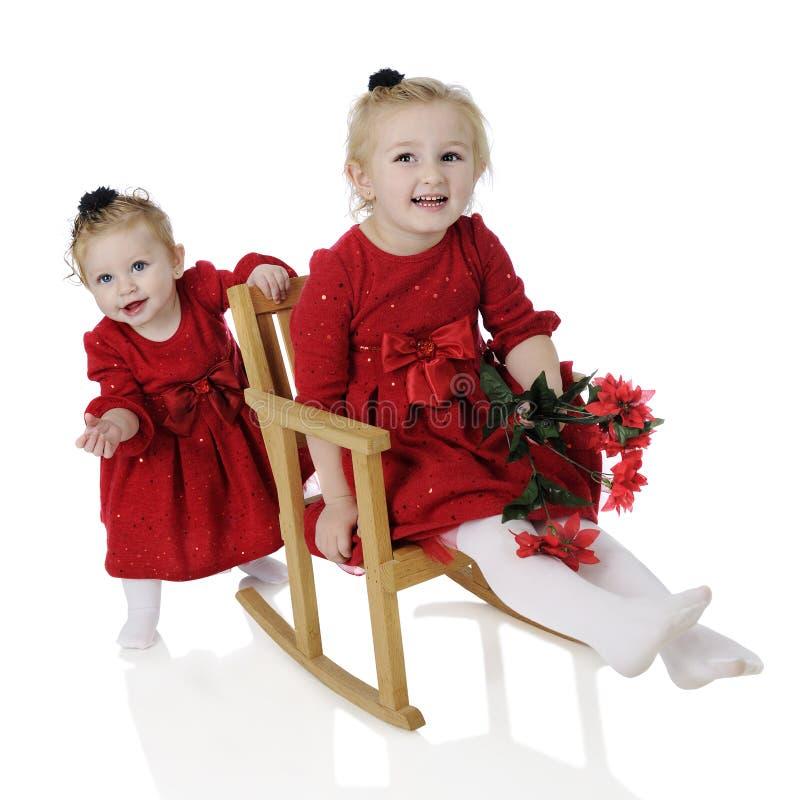 Radosne Bożenarodzeniowe siostry zdjęcia stock