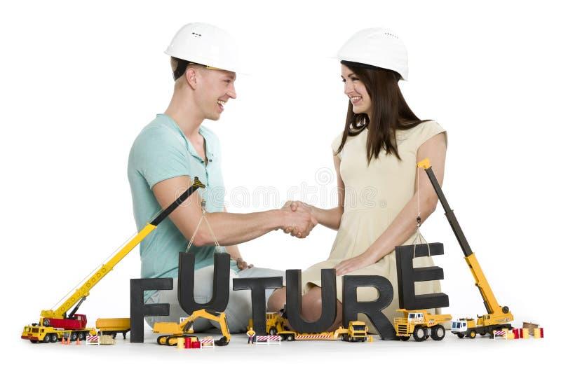 Radosny mężczyzna i kobieta buduje w górę ich przyszłości. fotografia stock