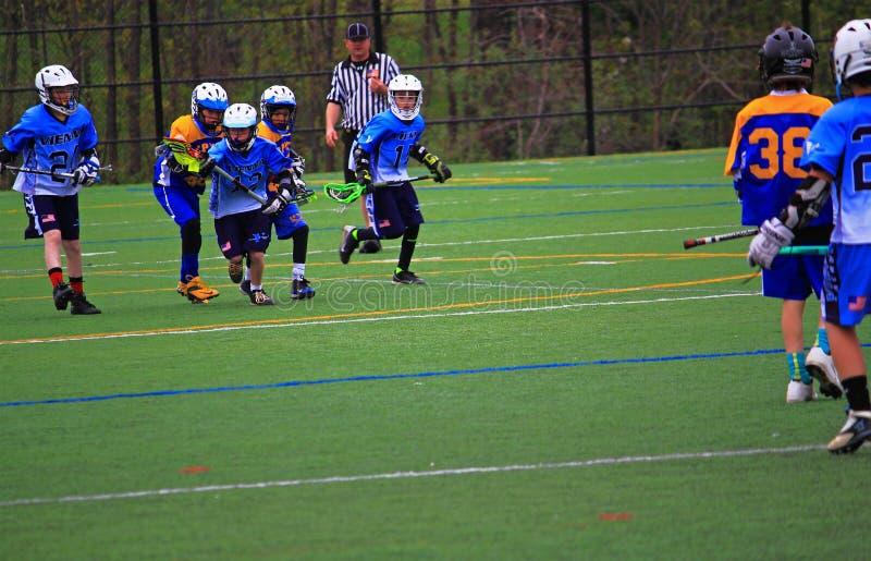Raduni di lacrosse del ragazzo fotografie stock libere da diritti