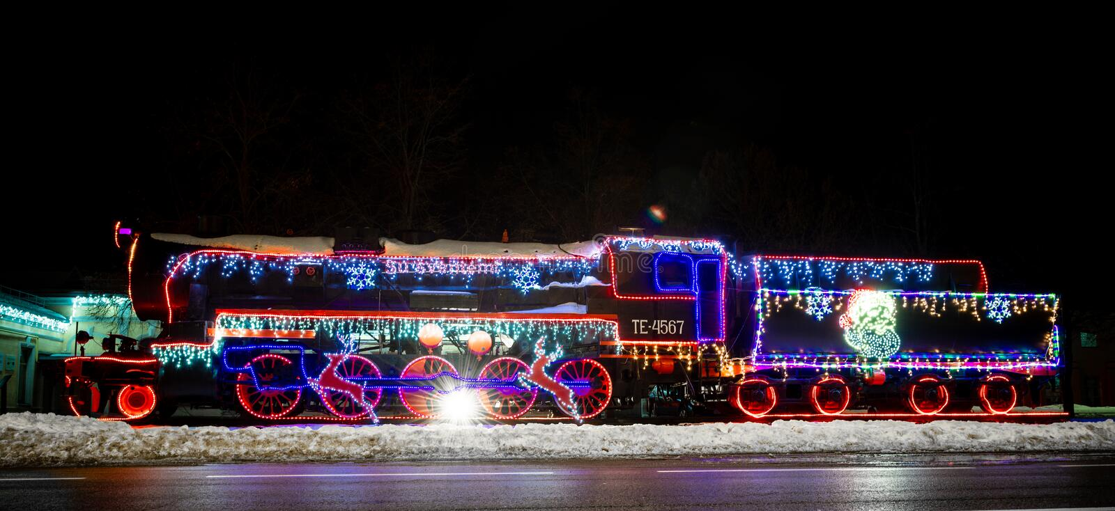 RADVILISKIS, LITHUANIA - DECEMBER 26, 2018: Colorful Old Train Locomotive with Christmas Lights on it. Colorful Old Train Locomotive with Christmas Lights on it stock photo