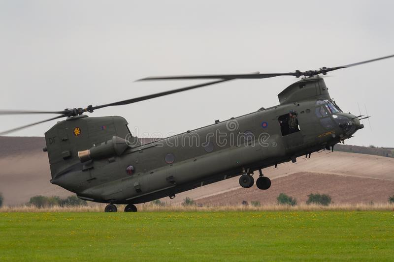 RAF CHINOOK HELICOPTER, ENGLAND, SEPTEMBER 8 2007, Royal Air Force RAF Chinook Landing in a field, England, United Kingdom royalty free stock photography